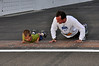 """""""Kissing the Bricks"""", at the finishing line is a IMS tradition being performed by Brett and Matthew.  This was Matthew's first running race."""