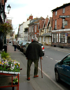 Dad's off up Church St in a hurry to get his pension at The Post Office.