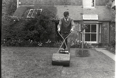 Dad always kept the Post Office garden neat and tidy and here he is cutting the lawn.