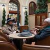 Bob talking with Vera in the lobby of Hotel Rott.