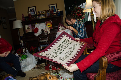 Helen and Nick opening personalized doormats.