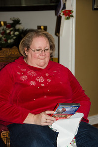 Kathy opening her gifts.