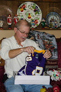 Bruce recieves a Viking's jersey.