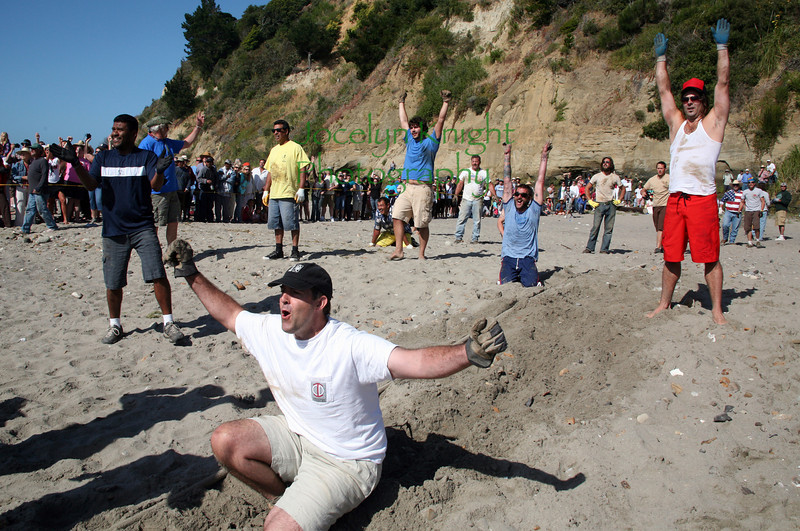 It's a WIN for Bolinas! The Bolinas Men's Pull ended in momentary confusion as the official stopped the action just 4 minutes after it started when 4 to 5 men on the Stinson Beach team were on their knees and being dragged toward the water's edge. The official said the rules require everyone to be on their feet at all times, making Bolinas the official winner of the pull this July 4, 2010 in Bolinas, CA.(Special to the IJ/Jocelyn Knight)
