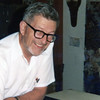 Grandpa Bob with one of his many puzzles; photo likely taken early 1980s.