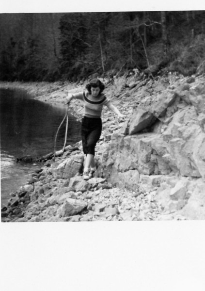 Grandma Ruth with a fishing net wearing her favorite saddle shoes and bobby socks