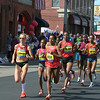 The womens' lead pack at Framingham, just past the 10K/6-mile spot.  Rita Jeptoo from Kenya, here about 6th, won the race in a new record for Boston: 2:18:57.  It was her third Boston win.