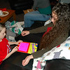Kimberly and Zac playing tic-tac-toe on a GlowSketch pad.