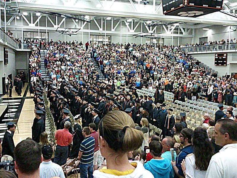 Graduates filing in