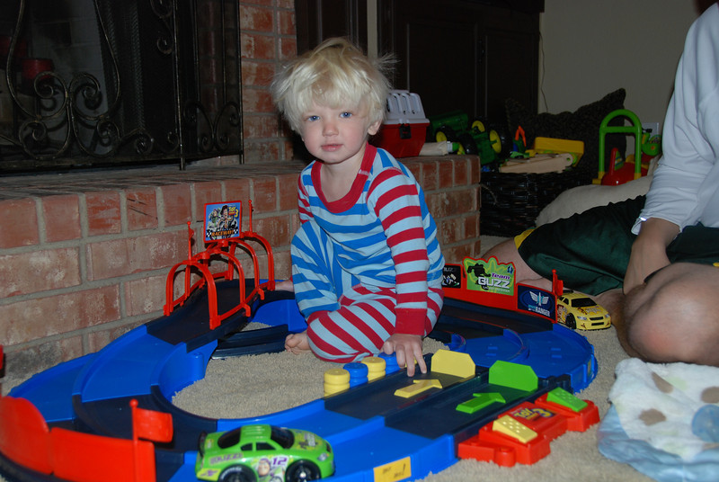 Birthday boy found his first gift - a Toy Story race track