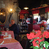 Eating breakfast at a small rustic cafe.  The food was great....we came back here again....