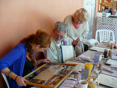 Edel, Joey, and Mom looking at photos from an earlier visit to Ireland