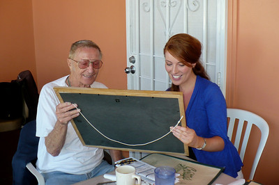 Uncle Jim Walsh and Edel looking at photos from an earlier visit to Ireland