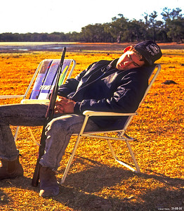 Glen Laycock has a after breakfast relax at lake before a big day of pig hunting on Hawkins Mowbray