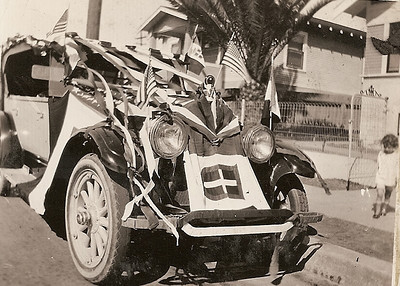 Bregante family decorated car at home on Kettner Blvd in the 1920s.