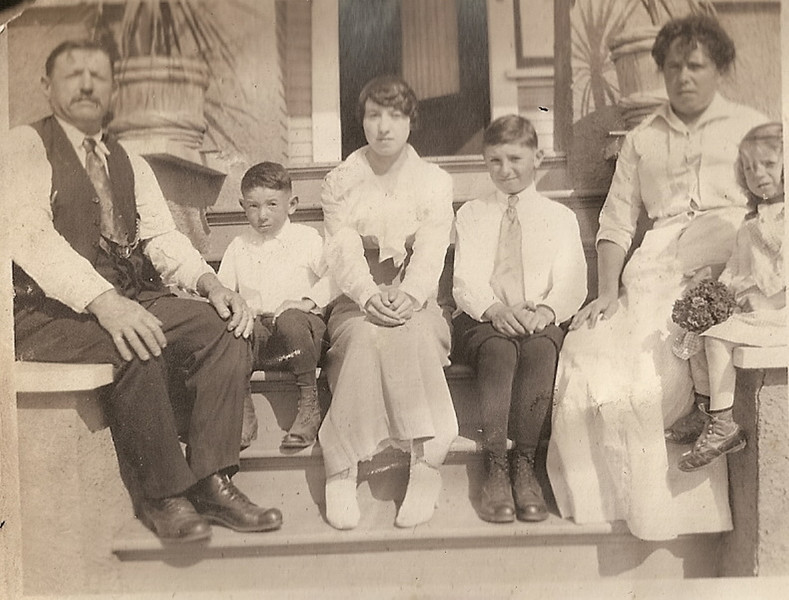 Bregante family on front porch, 1753 Arctic St, 1912. (Arctic name changed to Kettner Blvd. in 1921). Gerolamo, John, Katherine, James, Palmira, and Edna.