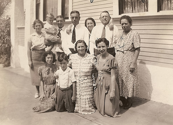 Gerolamo Bregante's 70th birthday, September 18, 1938, at his residence at 1753 Kettner Blvd. Front row L-R: Elsie Stagnaro, Andy Stagnaro, Edna Bregante Zuanich, Lillian Stagnaro;  Back row L-R: Angelina Ghio Bregante, James Jr. and father James, Steve Stagnaro, Katherine Bregnte Stagnaro, Gerolamo Bregante and Palmira Bregante.