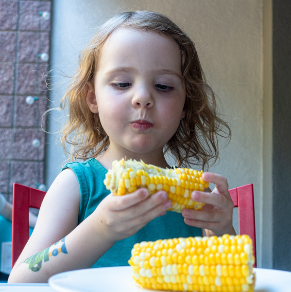 Fiona likes her corn...and her tattoo!