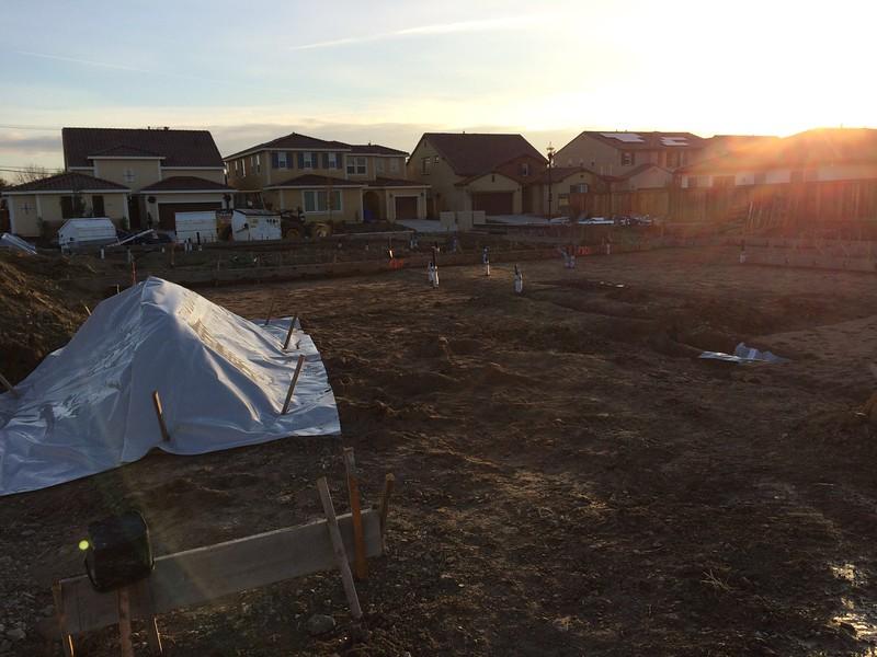 Dec 17 - Flattened lot, foundation framing started.