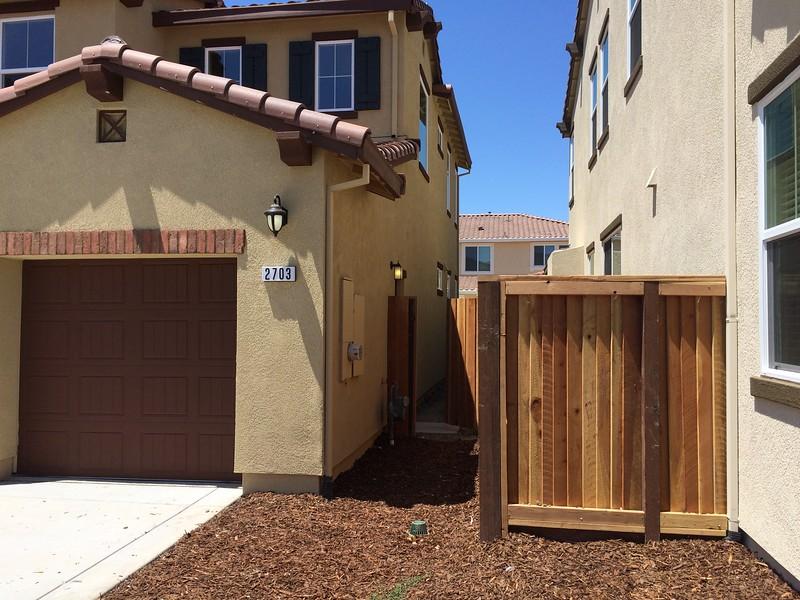 May 31 - Side walkway, utilities, gate, side door to garage.