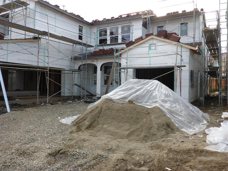 Mar 19 - Big pile of sand for the stucco.