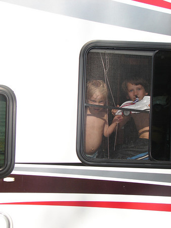Brian and Joey looking out the window of the trailer