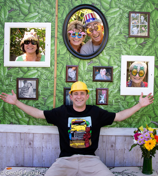 Brian sitting in front of the picture frame in his backyard.  Lauri is in the left picture frame, Jenny and I are in the center one, and Mom is peaking in the right one.