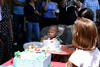 Kayden performing the time honored right of passage, making a mess with his first birthday cake.