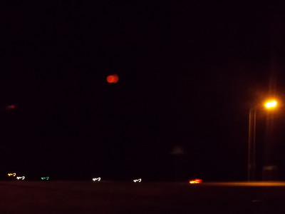 Red moon from all the smoke in the air