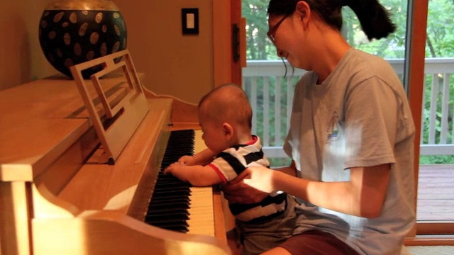At 4 months Bryce enjoys playing piano. He loves music!