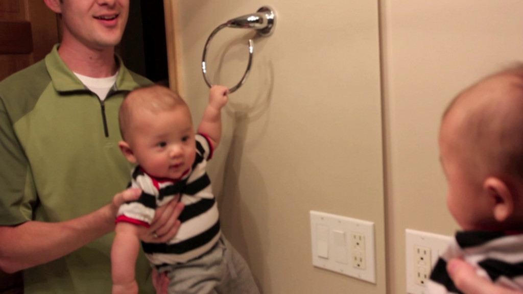 Bryce is really strong! He likes to do one-arm pull ups in front of the mirror.