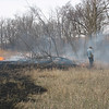 First you have to build a fire break and burn against the wind. Then we ran the fire along a fence line that divides the next door neighbors fields from my Brothers. My job was to keep his neighbors field from burning. <br /> So we lit the fire and the wind shifted...<br /> <br /> Go figure!