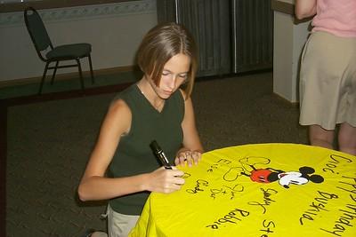 Clarissa signing poncho