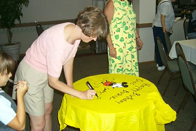 Cindy signing poncho