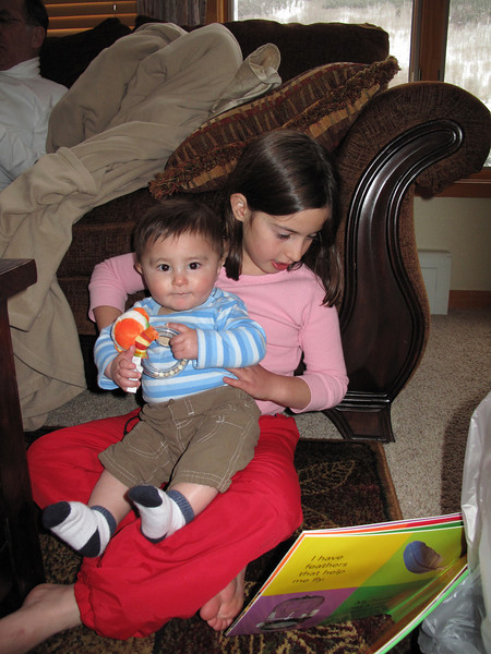 Zara reading to Austin