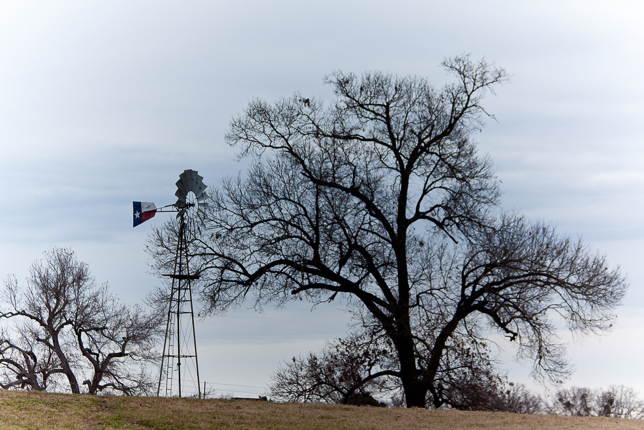 The flag of Texas painted on the windmill.