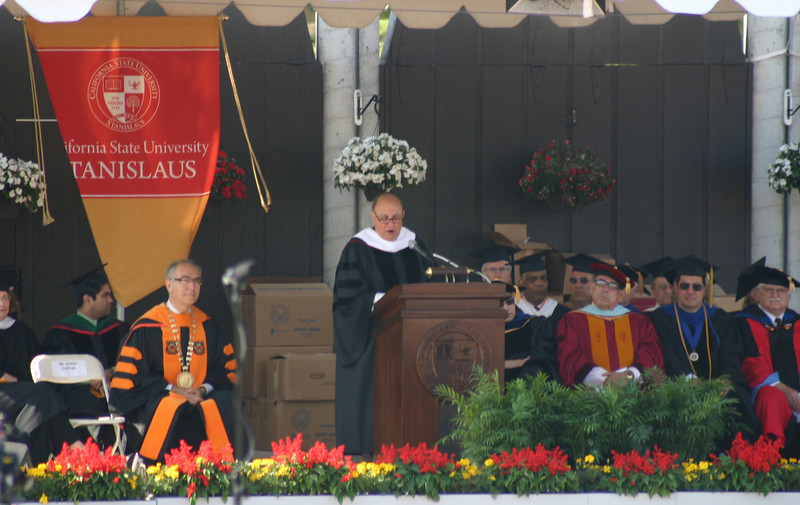 """The guest speaker, who received an Honorary Degree, was Harry Pappas, of <a href=""""http://en.wikipedia.org/wiki/Pappas_Telecasting_Companies"""">Pappas Telecasting Companies</a>. He said that he felt that he ought not to be here, with the companies' latest troubles, but the President assured him that his successes in business, personal, and community life, along with his challenges and how he faced them, were all worthy of acknowledging."""