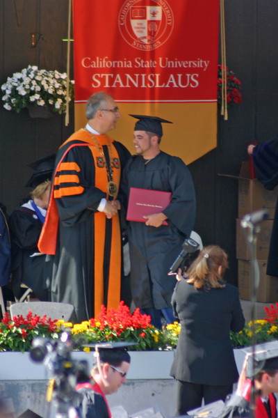My nephew shakes the President's hand.  (All of these photos were cropped out of VERY distant telephoto shots, so none are as clear as one might have wished. Seems to be the story of my life. Not to mention trying to see around the constant flow of people standing and walking in the aisle between me and there.)