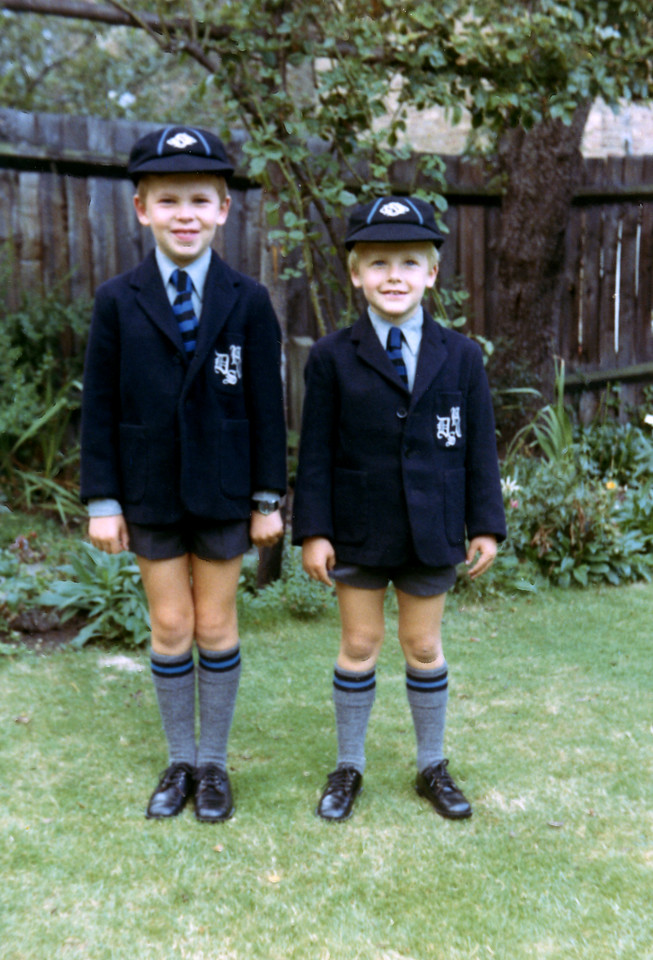 Andrew and James Calder in DCPS uniforms, in back garden of 42 Carson Road