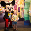 Zoe with Mickey Mouse at Disneyworld