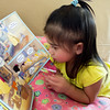 Melody reads her book