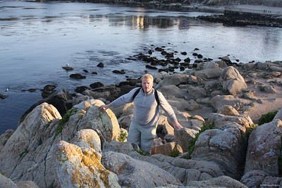 Richard climbing rocks  at Monterey, CA