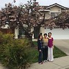 In front of Agnes' neighbor's tree that's in full bloom!