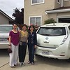 In front of their Nissan Leaf (& Vinh's Honda Accord)...