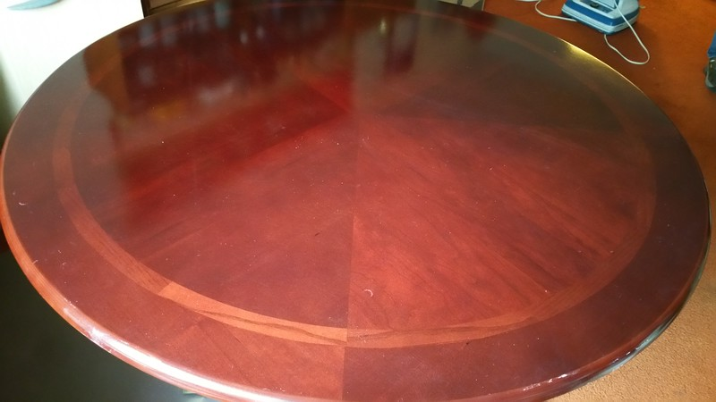 Wooden round table in the spare room that Steven & Jenny want to save.