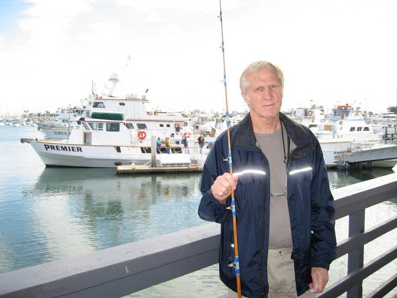 """Hum, Dad doesn't look too happy -guess the Starbucks had worn off by this time of day.<br /> <br /> This was taken from where we started at H&M Sportfishing Landing.  That's our boat in the background, the """"Premier""""."""