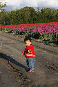Esther and the tulips with her tulip sweater