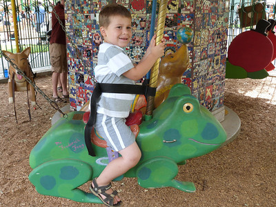 Joey at the Delta Breeze carousel at Central Park, Davis, CA