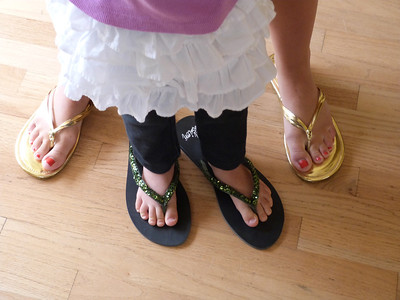 Annie and Cambria wearing Ari's shoes