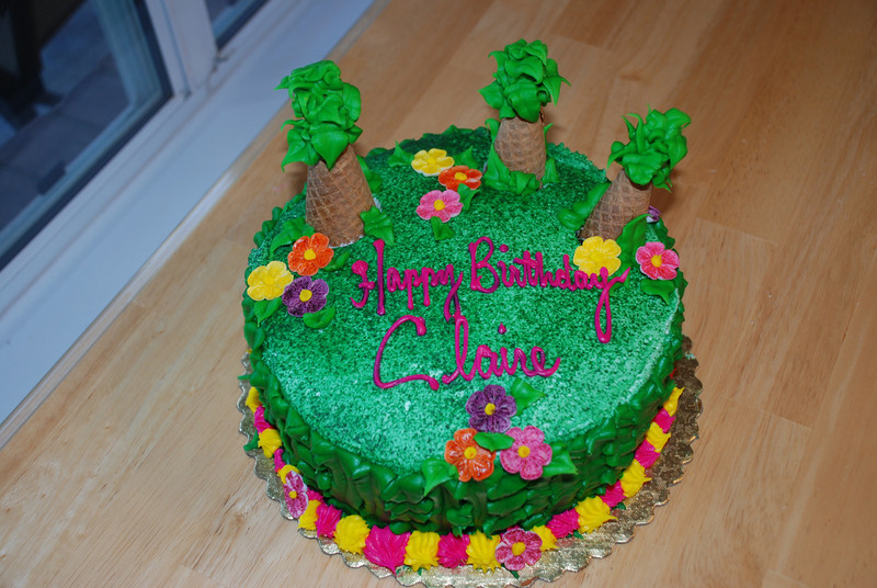 Claire's cake was very Hawaiian with flowers and palm trees.